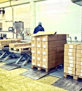 Lifting tables in packaging area