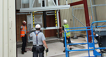 Workers installing lift