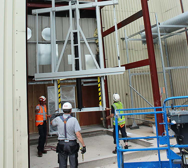Workers installing mast lift